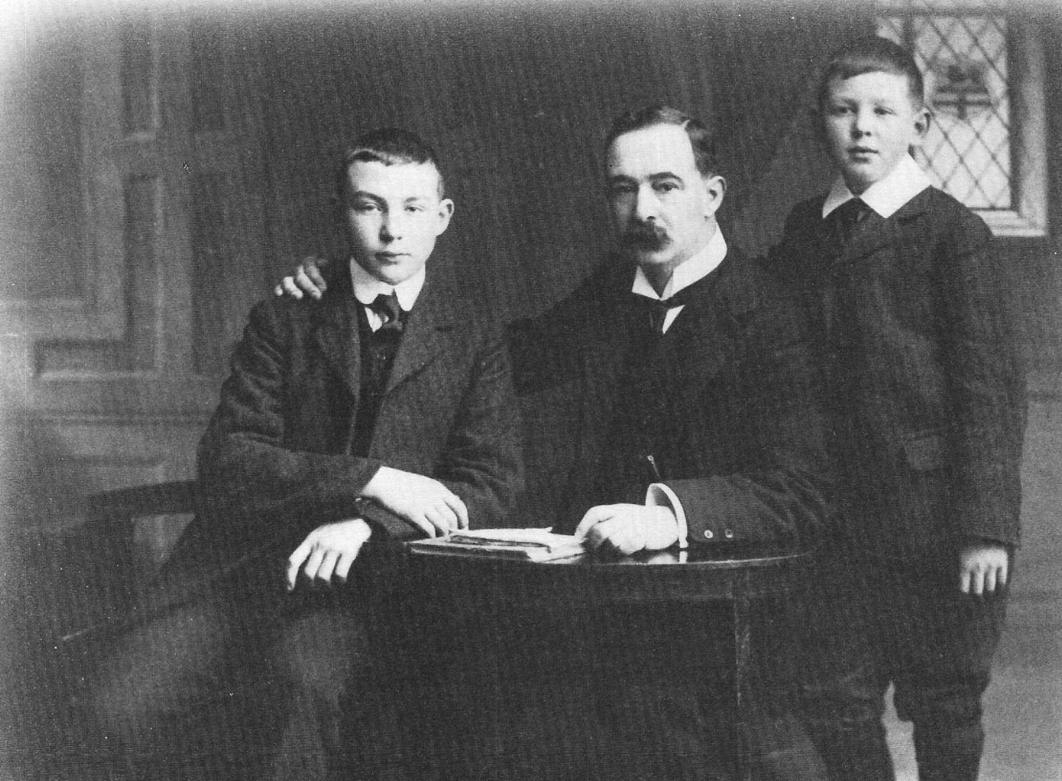 Lewis, his brother Warren, and his Father.